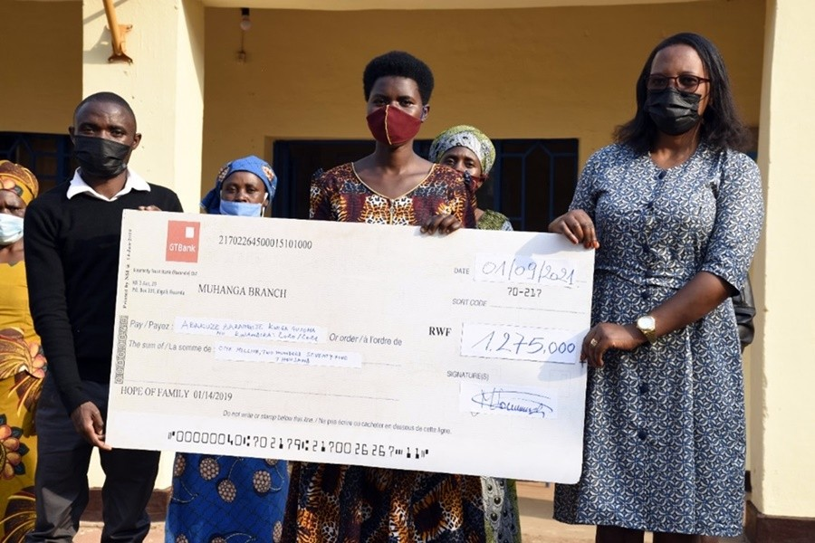 hope of family donates over a million rwandan francs to locals after graduating from adults literacy program...